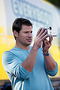 CINCINNATI, OH - OCTOBER 5:  Nick Lachey videotapes outside the tour bus he will be traveling in during the kickoff to The Everybody Wins Tour at Freestore Foodbank on October 5, 2009 in Cincinnati, Ohio. (Photo by Joe Robbins/WireImage for Foodbank)