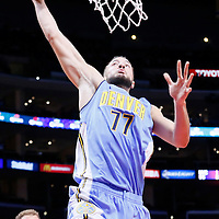 02 October 2015: Denver Nuggets forward Joffrey Lauvergne (77) goes for the dunk past Los Angeles Clippers forward Blake Griffin (32) and Los Angeles Clippers guard Wesley Johnson (33) during the Los Angeles Clippers 103-96 victory over the Denver Nuggets, in a preseason game, at the Staples Center, Los Angeles, California, USA.