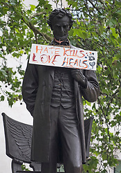 "© Licensed to London News Pictures. 08/06/2020. London, UK. A sign reading ""HATE KILLS, LOVE HEALS"" hung around a statue of former U.S President Abraham Lincoln in Parliament Square, during a Black Lives Matter demonstration In central London. The death of George Floyd, who died after being restrained by a police officer In Minneapolis, Minnesota, caused widespread rioting and looting across the USA. Photo credit: Ben Cawthra/LNP"