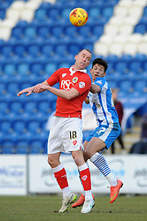 Bristol City's Aaron Wilbraham challenges for the header with Colchester United's Macauley Bonne - Photo mandatory by-line: Dougie Allward/JMP - Mobile: 07966 386802 - 21/02/2015 - SPORT - Football - Colchester - Colchester Community Stadium - Colchester United v Bristol City - Sky Bet League One