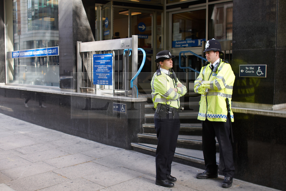 © licensed to London News Pictures. LONDON, UK  09/05/2011. Police guard the entrance to Westminster Magistrates Court on Horseferry Road as the 136 activists charged with aggravated trespass over the occupation of Fortnum and Masons on the 26 March begin appearing in court. Please see special instructions for usage rates. Photo credit should read CLIFF HIDE/LNP