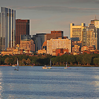 Boston skyline sunset photography featuring iconic skyscrapers and the third tallest in the city: The Millennium Tower. The foreground is made off building reflections in the Charles River and sailboats cruising along. The Millennium Tower, with its nickname Millie, is located at Downtown Crossing and is one of the latest Boston urban architecture skyline addition. Boston skyline photos are available as museum quality photography prints, canvas prints, acrylic prints or metal prints. Fine art prints may be framed and matted to the individual liking and decorating needs:<br />  <br /> http://juergen-roth.pixels.com/featured/charles-river-sailboats-with-boston-millennium-tower-juergen-roth.html<br /> <br /> All Boston photographs are available for digital and print image licensing at www.RothGalleries.com. Please contact me direct with any questions or request.<br /> <br /> Good light and happy photo making!<br /> <br /> My best,<br /> <br /> Juergen<br /> Prints: http://www.rothgalleries.com<br /> Photo Blog: http://whereintheworldisjuergen.blogspot.com<br /> Instagram: https://www.instagram.com/rothgalleries<br /> Twitter: https://twitter.com/naturefineart<br /> Facebook: https://www.facebook.com/naturefineart