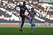 Peterborough United forward Ivan Toney (17) battles for possession  with Milton Keynes Dons defender Russell Martin (16) during the EFL Sky Bet League 1 match between Milton Keynes Dons and Peterborough United at stadium:mk, Milton Keynes, England on 24 August 2019.