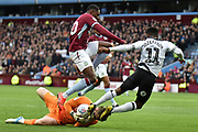 Aston Villa goalkeeper Jed Steer (12) makes an important save during the EFL Sky Bet Championship match between Aston Villa and Derby County at Villa Park, Birmingham, England on 2 March 2019.
