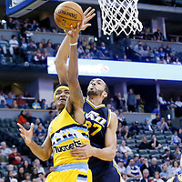 10 April 2016: Denver Nuggets guard Gary Harris (14) is rejected by Utah Jazz center Rudy Gobert (27) during the Utah Jazz 100-84 victory over the Denver Nuggets, at the Pepsi Center, Denver, Colorado, USA.