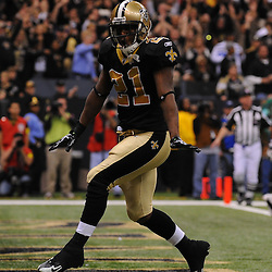 16 January 2010:  New Orleans Saints running back Mike Bell (21) celebrates after scoring a touchdown, but the play was nullified by an offensive holding penalty during a 45-14 win by the New Orleans Saints over the Arizona Cardinals in the 2010 NFC Divisional Playoff game at the Louisiana Superdome in New Orleans, Louisiana.