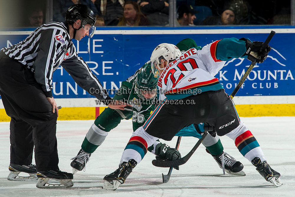 KELOWNA, CANADA - FEBRUARY 15: Conner Bruggen-Cate #20 of the Kelowna Rockets faces off against Reece Vitelli #26 of the Everett Silvertips  on February 15, 2019 at Prospera Place in Kelowna, British Columbia, Canada.  (Photo by Marissa Baecker/Shoot the Breeze)