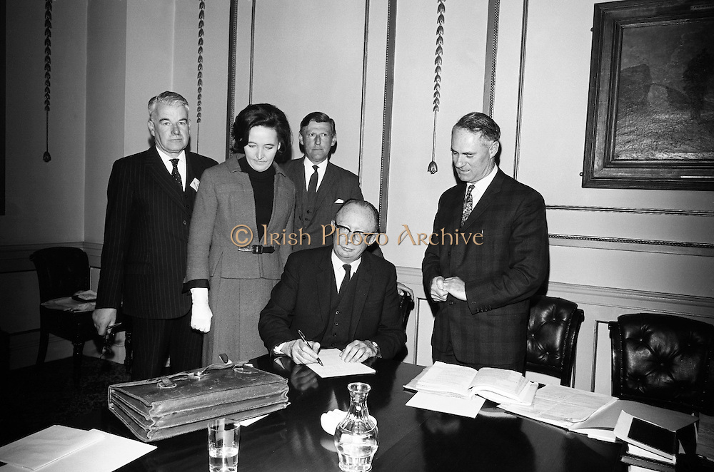 Candidates Nominated for Presidency. Mr. T.F. O'Higgins T.D., Fine Gael, who was nominated for the presidency, signing the papers of Mr. Hussey as his election agent in the presence of the returning officer Mr. Shane O'Hanlon at the Custom House, Dublin. Also in the picture are Mr. Gerald Sweetman (left) and Mrs. O'Higgin..10.05.1966