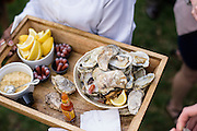 Annapolis, Maryland - April 18, 2015: Grilled oysters were one of the appetizers served during Stephanie Shearer Cate and Winston Bao Lord's wedding at their friends Jeff and Marry Zients' house in Annapolis, Maryland Saturday April 18, 2015. <br /> <br /> <br /> <br /> CREDIT: Matt Roth for The New York Times<br /> Assignment ID: 30173318A