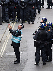 © Licensed to London News Pictures . 11/06/2013 . London , UK . A police liaison officer talks to occupying protesters . Police surround a former police station on 40 Beak Street , Soho this morning (11th June) . The site has been occupied by organisers of today's Stop G8 anti capitalist protests . Demonstrations in London today (Tuesday 11th June 2013) ahead of Britain hosting the 39th G8 summit on 17th/18th June at the Lough Erne Resort , County Fermanagh , Northern Ireland , next week . Photo credit : Joel Goodman/LNP