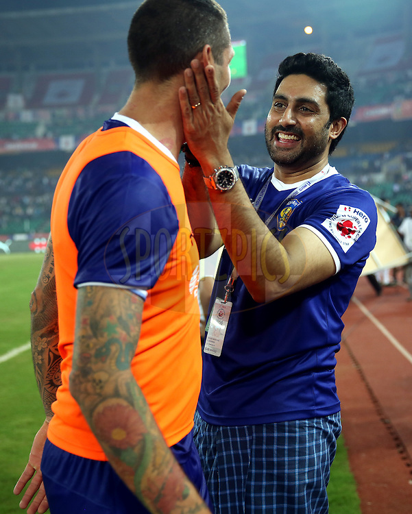 Marco Materazzi of Chennaiyin FC and Actor Abhishek Bachchan  owner of Chenaiyin FC celbrates after winning the match 15 of the Hero Indian Super League between Chennaiyin FC and Mumbai City FC held at the Jawaharlal Nehru Stadium, Chennai, India on the 28th October 2014.<br /> <br /> Photo by:  Sandeep Shetty/ ISL/ SPORTZPICS