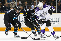 November 15, 2010; San Jose, CA, USA;  Los Angeles Kings right wing Justin Williams (14) attempts to clear the puck past San Jose Sharks defenseman Jason Demers (60) and center Logan Couture (39) during the first period at HP Pavilion. Mandatory Credit: Jason O. Watson / US PRESSWIRE