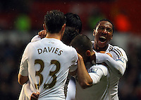 Saturday, 03 November 2012..Pictured: Pablo Hernandez of Swansea celebrating his equaliser, is mobbed by team mates Ben Davies (33), Jonatha De Guzman (R) and other players..Re: Barclays Premier League, Swansea City FC v Chelsea at the Liberty Stadium, south Wales.