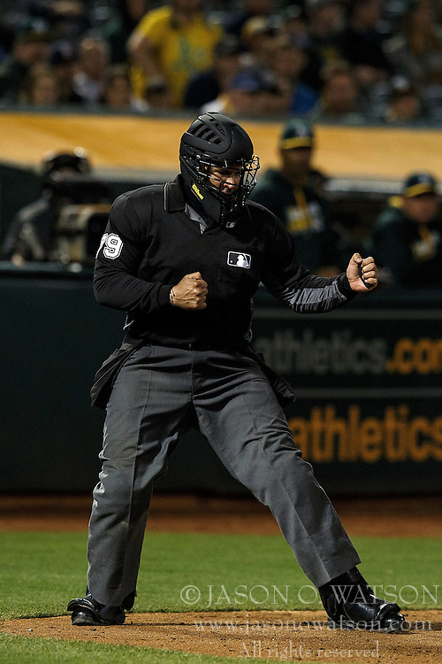 OAKLAND, CA - JULY 19:  MLB umpire Manny Gonzalez #79 calls a third strike during the ninth inning between the Oakland Athletics and the Houston Astros at the Oakland Coliseum on July 19, 2016 in Oakland, California. The Oakland Athletics defeated the Houston Astros 4-3 in 10 innings.  (Photo by Jason O. Watson/Getty Images) *** Local Caption *** Manny Gonzalez