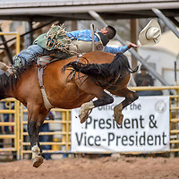 Kyle Charley's hat floats away in his 88-point bareback ride during the Navajo Nation Fair rodeo at the Navajo Nation Fairgrounds in Window Rock Saturday.