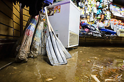 © Licensed to London News Pictures. 08/12/2015. Glen ridding UK. Picture shows the clear up in a shop in the centre of Glenridding. The village of Glenridding has been cut of from the outside world for four days with no water, electricity or telephone lines after huge torrents of water from the surrounding mountains destroyed roads leading to it & flooded the village centre. Photo credit: Andrew McCaren/LNP