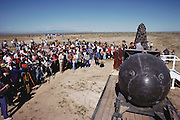 Site Trinity ground zero, the still radioactive piece of desert in the White Sands Missile Range, which was witness to the world's first nuclear explosion on August 6, 1945. Each year the site is open to the public for one day. Visitors to ground zero listen to a Manhattan Project scientist reminisce while standing next to an original Fat Man bomb casing, on loan from the nearby Atomic Museum in Albuquerque, New Mexico.