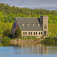 Abandoned Old Stone Church in West Boylston of Central Massachusetts on a beautiful spring morning. The morning light painted this historic landmark and surrounding trees in beautiful warm hues. <br />