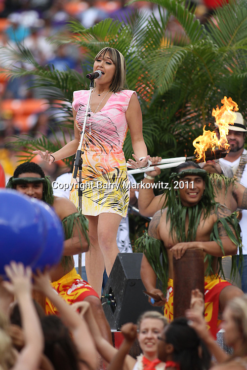 Hawaii singing sensation, Anahea, entertains at halftime of the NFL Pro Bowl, Aloha Stadium, as Samoan firekinives light up and balloons float by. 1/30/11, Photo by Barry Markowitz