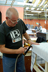 Remploy factory; Forest Hall; Newcastle; UK 2007, Remploy provides specialist employment services to disabled people and those who face barriers to employment, Man making bed base; fastening fabric cover
