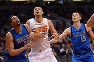 Apr 9, 2017; Phoenix, AZ, USA; Dallas Mavericks center AJ Hammons (20) boxes out Phoenix Suns center Alex Len (21) in the second half of the NBA game at Talking Stick Resort Arena. The Suns won 124-111. Mandatory Credit: Jennifer Stewart-USA TODAY Sports