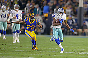Jan 12, 2019; Los Angeles, CA, USA;  Dallas Cowboys wide receiver Michael Gallup (13) breaks free from a tackle from Los Angeles Rams cornerback Marcus Peters (22) during an NFL divisional playoff game at the Los Angeles Coliseum. The Rams beat the Cowboys 30-22. (Kim Hukari/Image of Sport)