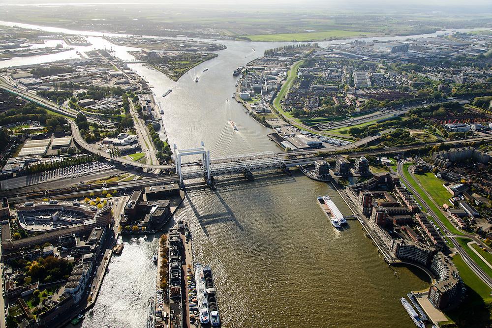 Nederland, Zuid-Holland, Dordrecht, 23-10-2013; spoorbrug over de Oude Maas, bijnaam Het Hemelbed, splitsing met Dordsche Kil (naar links, richting Hollandsch Diep). Daarnaast de Stadsbrug, waarvan de verkeersstroom tegenwoordig door de Drechttunnel gaat.<br /> Railway bridge, road bridge and road tunnel of the Oude Maas in Dordrecht<br /> luchtfoto (toeslag op standaard tarieven);<br /> aerial photo (additional fee required);<br /> copyright foto/photo Siebe Swart.