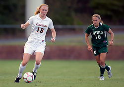 Virginia Cavaliers forward Maggie Kistner (16) dribbles past Loyola Greyhounds midfielder Theresa Ferraina (10).  The #6 Virginia Cavaliers defeated the Loyola College Greyhounds 4-0 in a NCAA Women's Soccer game held at Klockner Stadium on the Grounds of the University of Virginia in Charlottesville, VA on August 22, 2008.