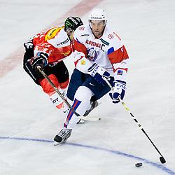 Tomaz Razingar of Slovenia vs Benjamin Pluss of Switzerland during friendly ice-hockey match between Slovenia and Switzerland, on December 14, 2011 at Hala Tivoli, Ljubljana, Slovenia. (Photo By Matic Klansek Velej / Sportida)