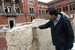 © Licensed to London News Pictures.31/10/2013. London, UK. A member of staff works on the installation of the Chinese artist Xu Bing by the lake of he John Madejski Garden at V&A Museum, where his new installation is shown. Travelling to the Wonderland inspired by the classic Chinese fable Tao Hua Yuan (The Peach Blossom Spring). The V&A invited Xu Bing to create a major new work to coincide with the Museum's forthcoming exhibition, Masterpieces of Chinese Painting 700 – 1900.Photo credit : Peter Kollanyi/LNP