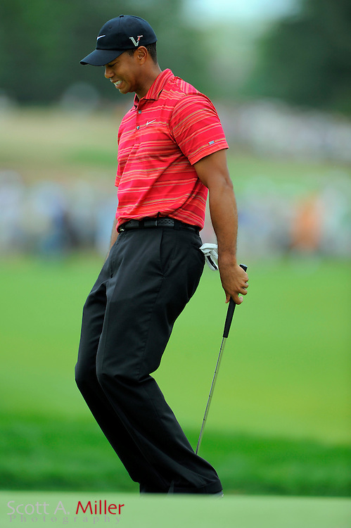 Aug 16, 2009; Chaska, MN, USA; Tiger Woods (USA) reacts to a missed putt on the 11th green during the final round of the 2009 PGA Championship at Hazeltine National Golf Club.  ©2009 Scott A. Miller