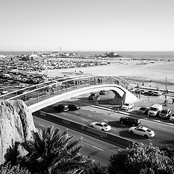 Santa Monica Beach pedestrian bridge and pier with Pacific Coast Highway in black and white. Photo Copyright ⓒ 2017 Paul Velgos with All Rights Reserved.