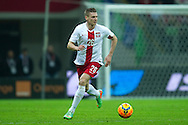 Poland's Lukasz Piszczek controls the ball during international friendly soccer match between Poland and Scotland at National Stadium in Warsaw on March 5, 2014.<br /> <br /> Poland, Warsaw, March 5, 2014<br /> <br /> Picture also available in RAW (NEF) or TIFF format on special request.<br /> <br /> For editorial use only. Any commercial or promotional use requires permission.<br /> <br /> Mandatory credit:<br /> Photo by © Adam Nurkiewicz / Mediasport