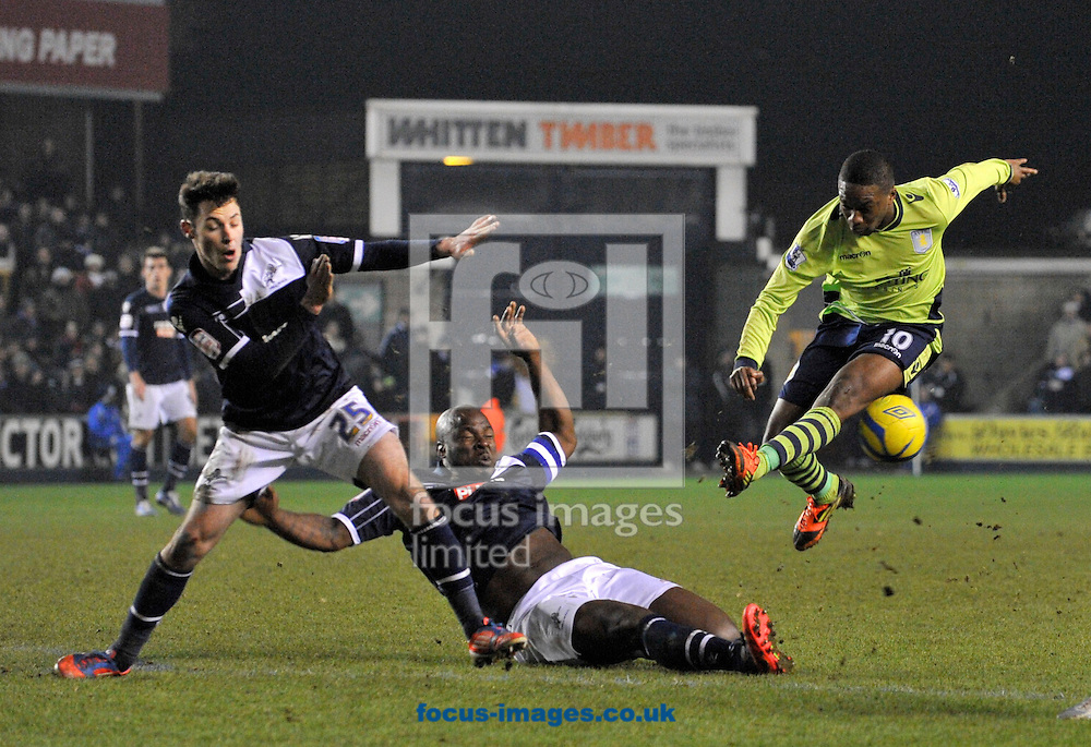 Picture by Alan Stanford/Focus Images Ltd +44 7915 056117.25/01/2013.Adam Smith and Danny Shittu ( on the ground) of Millwall and Charles N'Zogbia of Aston Villa during the The FA Cup match at The Den, London.