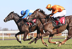 Erick Le Rouge and Chester Williams (orange colours) clear the last flight in company with Not That Fuisse and Dan Skelton before winning The 888Sport Handicap Hurdle Race run at Kempton Park Racecourse.