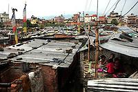 Young kids play in a home in a shantytown in Kathmandu on June 7, 2006. (Photo/Scott Dalton)