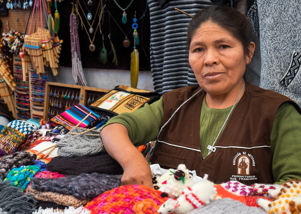 AREQUIPA, PERU - CIRCA APRIL 2014: Peruvian woman selling traditional crafts in Arequipa. Arequipa is the Second city of Perú by population with 861,145 inhabitants and is the second most industrialized and commercial city of Peru.