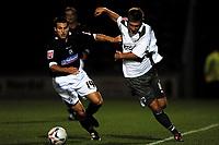 Photo: Richard Lane.<br />Northampton Town v Bristol City. Coca Cola League 1. 29/08/2006. <br />City's David Noble (rt) is challenged by Joe Burnell.