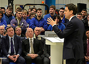 © Licensed to London News Pictures. 14/02/2013. Bedford, UK. Ed Miliband delivers his speech, watched by apprentices. Ed Miliband MP, Leader of the Labour Party, delivers a major speech at Bedford Training Group in Bedford today, 14th February 2013. In the speech he set out a 'One Nation Labour agenda for rebuilding Britain's economy'. The speech was followed by a Q&A session with Ed Balls, Shadow Chancellor and a tour of the training facility. Photo credit : Stephen Simpson/LNP