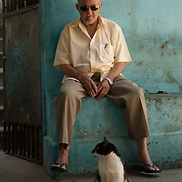 The cat admiring man from Santa Marta Community .