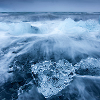 Iceland, Skaftafell National Park, Icebergs from Vatnajokull Glacier in waves from North Atlantic Ocean at Jokulsarlon