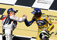 American Nicky Hayden congratulates Italy's Valentino Rossi for winning the Commercial Bank Grand Prix of Qatar, MOTO GP class, Losail International Circuit, 8 April 2006