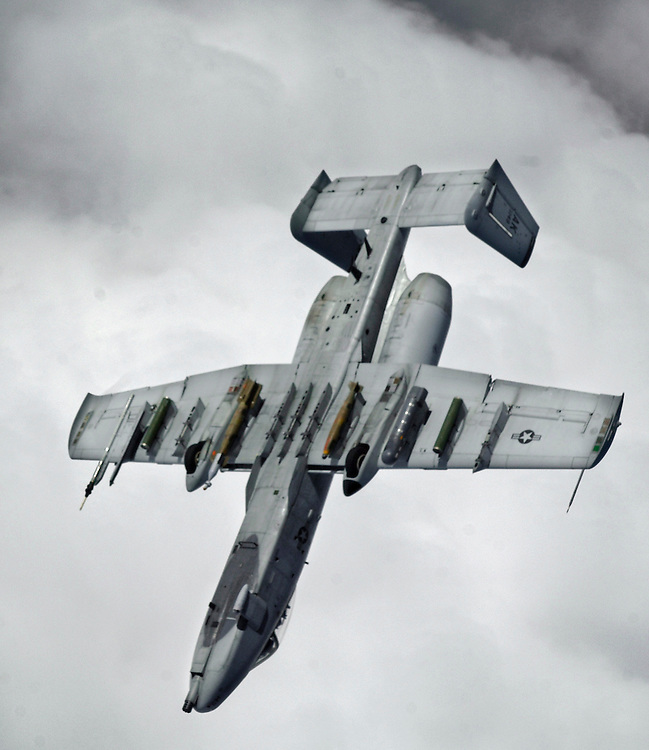 "Capt. ""Nick"" pilots his OA/A-10 Thunderbolt II observation / attack aircraft into a snap roll, to dive thousands of feet, to his low level close air support mission below, after completing an air refueling with  a KC-135R/T on 26 March 2006. Capt. Dicapua a native of Flower Mount, Tx. is deployed to the 355th Expeditionary Fighter Squadron, Bagram Air Base, Afghanistan, from the 355th Fighter Squadron, Eielson, Air Force Base Alaska. The KC-135R/T is deployed to the 22 Expeditionary Air Refueling Squadron, Manas Air Base, Kyrgyz Republic, from the 92nd Air Refueling Wing, Fairchild Air Force Base, Wash. (U.S. Air Force photo by Master Sgt. Lance Cheung)"