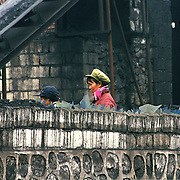 There are a lot of women working in coal mining  in China. They are not allowed underground due to superstitious belief that they would bring bad luck but they work in overground mining. Their tasks are equal to men.  Wangjizhai, South West  China.