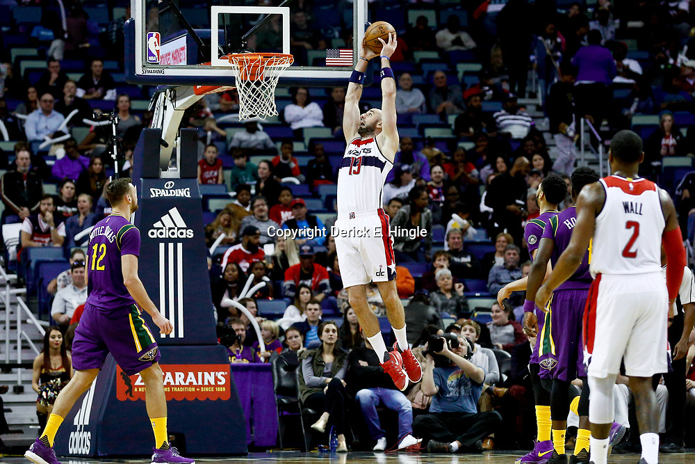 Jan 29, 2017; New Orleans, LA, USA; Washington Wizards center Marcin Gortat (13) dunks against the New Orleans Pelicans during the fourth quarter of a game at the Smoothie King Center. The Wizards defeated the Pelicans 107-94. Mandatory Credit: Derick E. Hingle-USA TODAY Sports