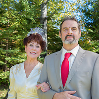 October wedding in Finlayson, Minnesota. Bride wore a classic wedding dress from 1945. Wedding party wore red accents. A beautiful country theme. The ceremony was at their cabin.