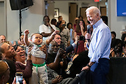 Former Vice President Joe Biden jokes with a small child during a town hall meeting at the International Longshoreman's Association Hall July 7, 2019 in Charleston, South Carolina.