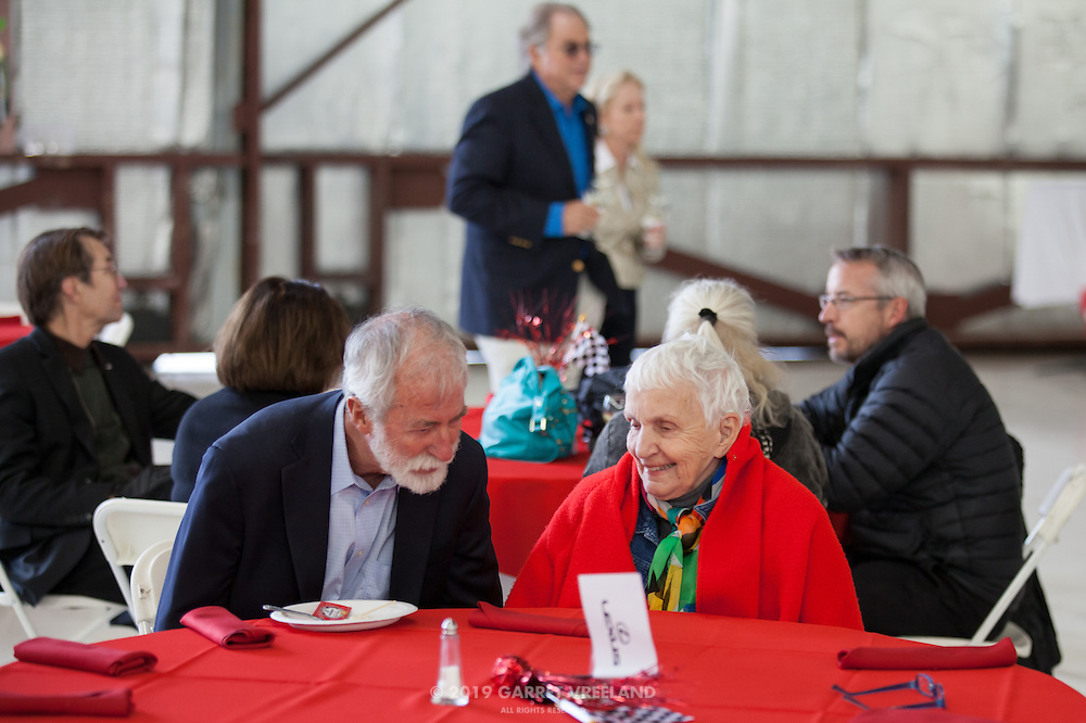 Denise McCluggage discusses racing with an attendee, Planes and Cars at the Santa Fe Airport, 2013 Santa Fe Concorso.