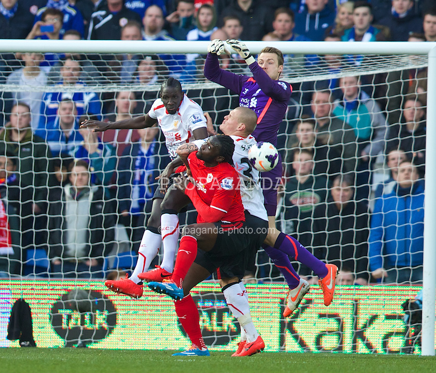 CARDIFF, WALES - Saturday, March 22, 2014: Liverpool's goalkeeper Simon Mignolet in action against Cardiff City during the Premiership match at the Cardiff City Stadium. (Pic by David Rawcliffe/Propaganda)