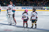 KELOWNA, CANADA - MARCH 11: The Pepsi Save On Foods Players of the Game line up on beside Jackson Whistle #1 of Kelowna Rockets March 11, 2015 at Prospera Place in Kelowna, British Columbia, Canada.  (Photo by Marissa Baecker/Shoot the Breeze)  *** Local Caption *** Pepsi Save On Foods Players; Jackson Whistle;